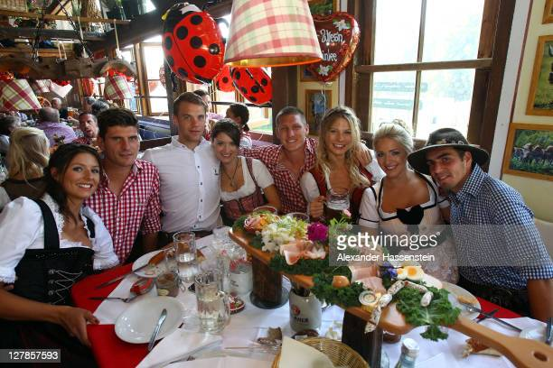 Players of Bayern Muenchen attend with their partners the Oktoberfest beer festival at the Kaefer Wiesnschaenke tent: Mario Gomez and Lisa, Manuel...