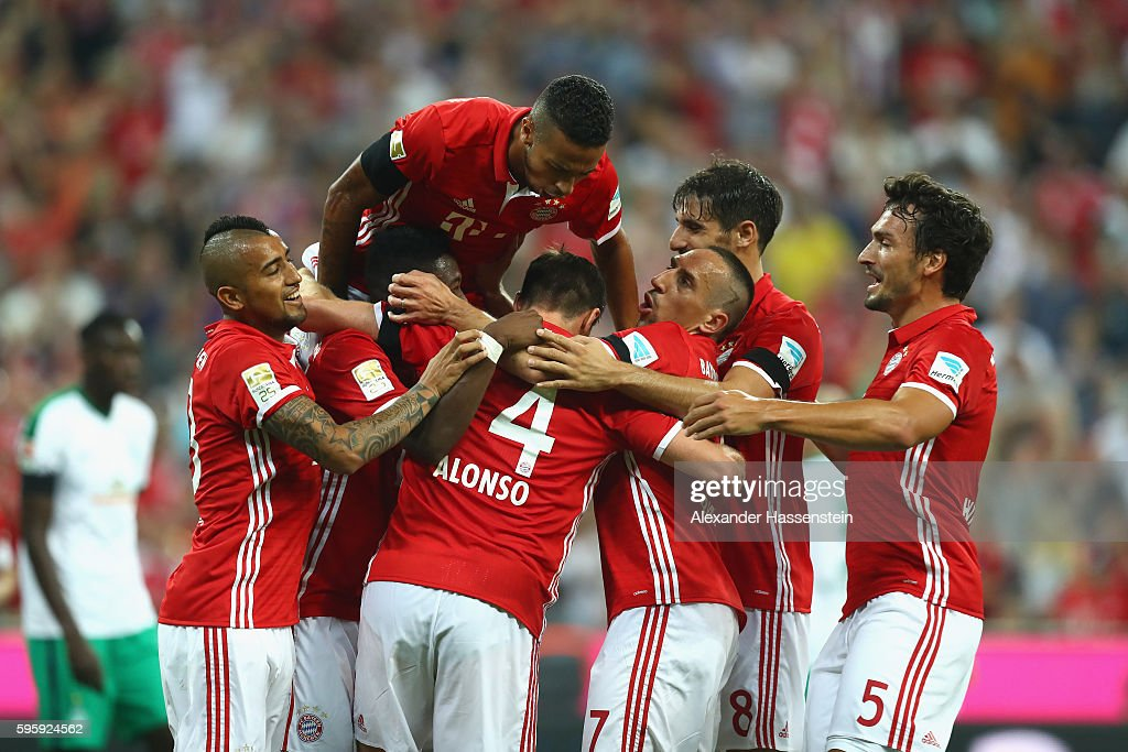 Players of Bayern Muenchen celebrate the first team goal during the Bundesliga match between Bayern Muenchen and Werder Bremen at Allianz Arena on August 26, 2016 in Munich, Germany.