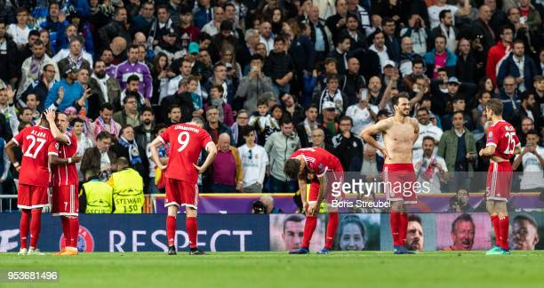 Players of Bayern Muenchen look dejected after losing the UEFA Champions League Semi Final Second Leg match between Real Madrid and Bayern Muenchen...