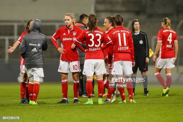 Players of Bayern Muenchen looks dejected after the Women's DFB Cup Quarter Final match between FC Bayern Muenchen and VfL Wolfsburg at the Stadion...