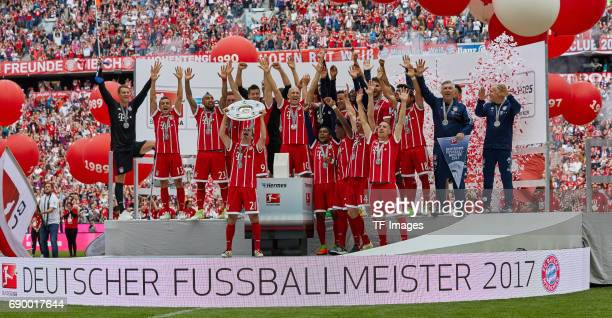 Players of Bayern Muenchen poses with the Championship trophy in celebration of the 67th German Championship title following the Bundesliga match...