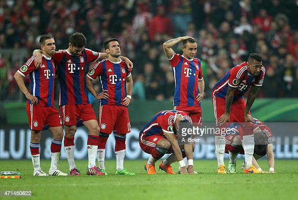Players of Bayern Muenchen react after a missed penalty goal during the penalty shootout of the DFB Cup semi final match between FC Bayern Muenchen...