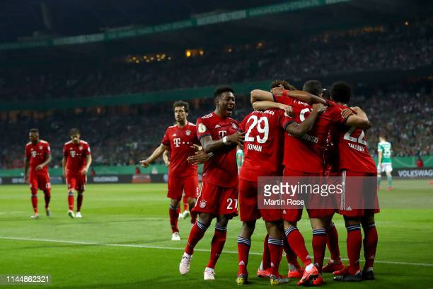 Players of Bayern Munich celebrate after scoring first goal during the DFB Cup semi final match between Werder Bremen and FC Bayern Muenchen at...