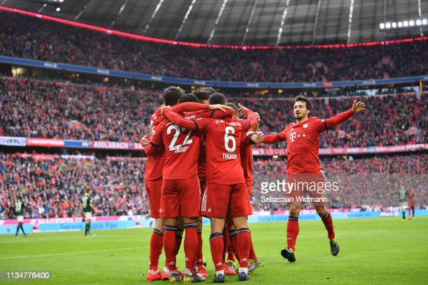 Players of Bayern Munich celebrate their team's second goal during the Bundesliga match between FC Bayern Muenchen and VfL Wolfsburg at Allianz Arena...