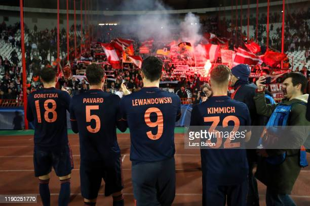 Players of Bayern Munich celebrate with fans following victory in the UEFA Champions League group B match between Crvena Zvezda and Bayern Muenchen...