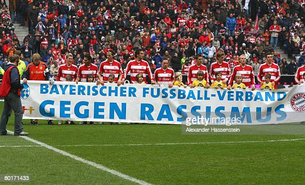 Players of Bayern Munich show their sympathy for an anti racism campaign of the Bavarian Football Association prior to the Bundesliga match between...