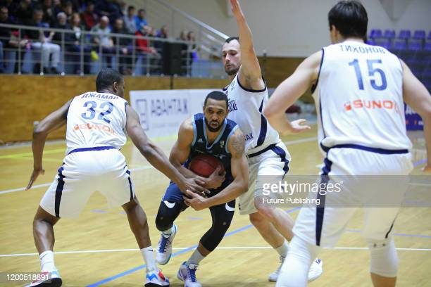 Players of BC Kharkivski Sokoly and BC Dnipro are seen in action during the Ukrainian Basketball SuperLeague match in Kharkiv, northeastern Ukraine....