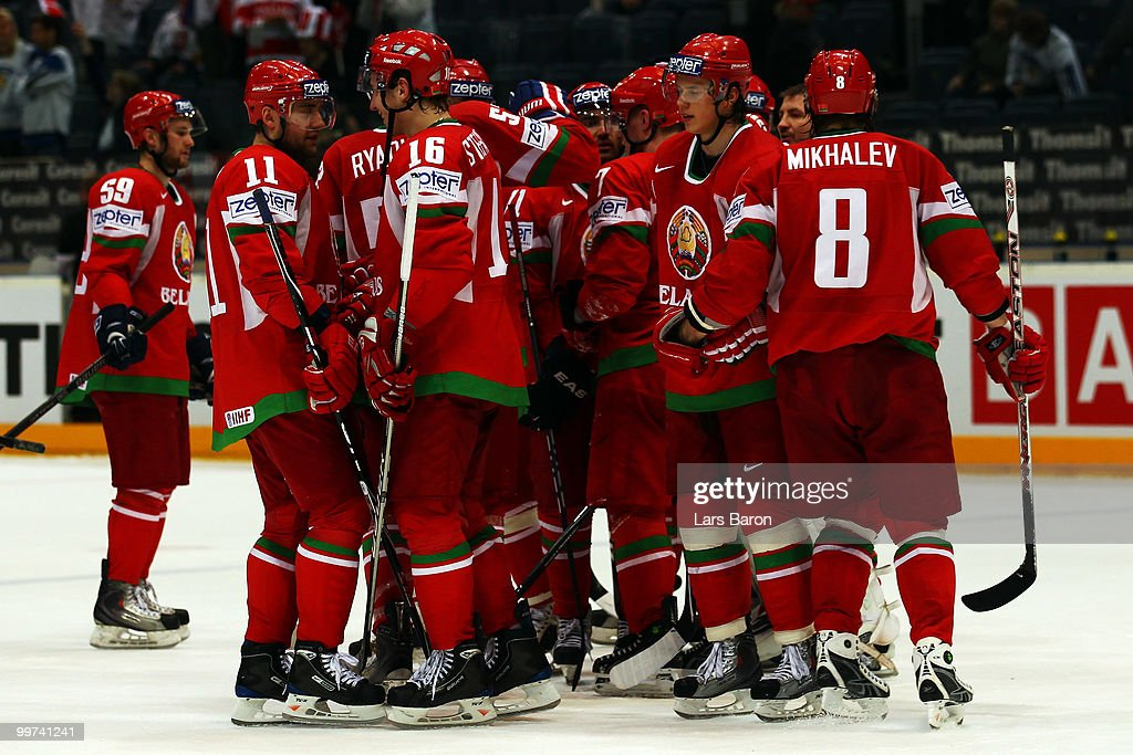 Players of Belarus celebrate after winning the IIHF World Championship qualification round match between Belarus and Denmark at Lanxess Arena on May 17, 2010 in Cologne, Germany.