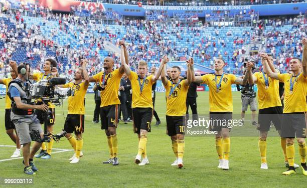 Players of Belgium acknowledge supporters after their 20 win against England in the World Cup playoff for third place at Saint Petersburg Stadium in...