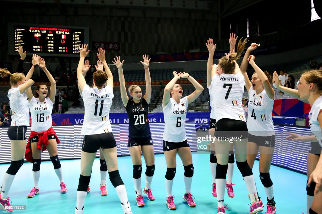 Players of Belgium celebrate after defeating the Dominican Republic during the FIVB Volleyball Nations League 2018 at Beilun Gymnasium on May 17, 2018 in Ningbo, China.