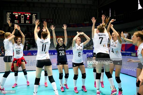 Players of Belgium celebrate after defeating the Dominican Republic during the FIVB Volleyball Nations League 2018 at Beilun Gymnasium on May 17 2018...