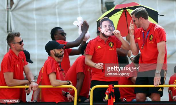 Players of Belgium national team greet their supporters on a bus at Grand Place as they arrive in Brussels after they won the 2018 FIFA World Cup...