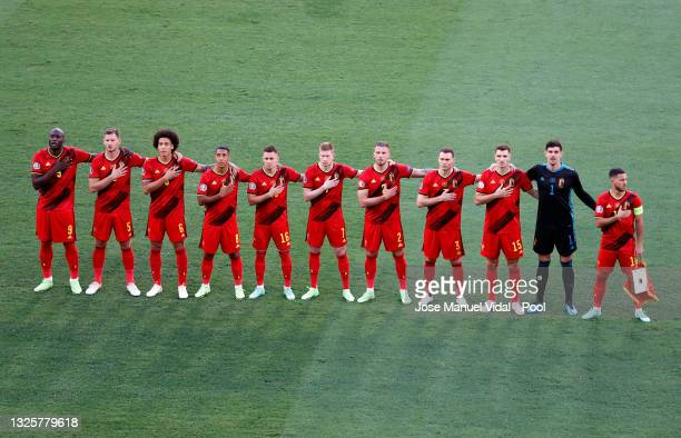 Players of Belgium stand for the national anthem prior to the UEFA Euro 2020 Championship Round of 16 match between Belgium and Portugal at Estadio...