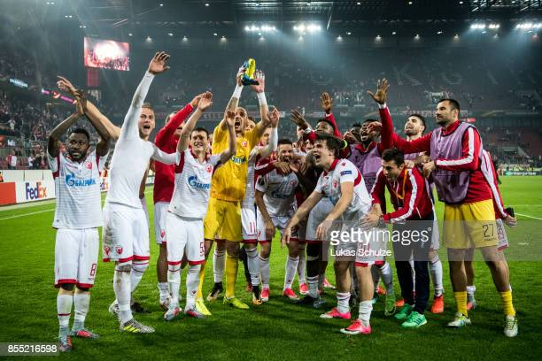 Players of Belgrade celebrate their win after the UEFA Europa League group H match between 1 FC Koeln and Crvena Zvezda at RheinEnergieStadion on...