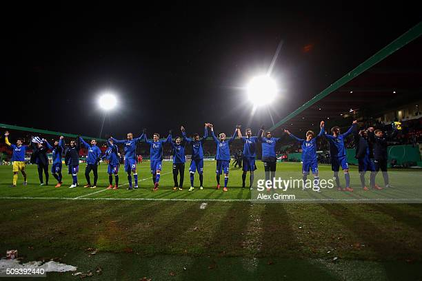 Players of Berlin celebrate after the DFB Cup Quarter Final match between 1. FC Heidenheim and Hertha BSC Berlin at Voith-Arena on February 10, 2016...