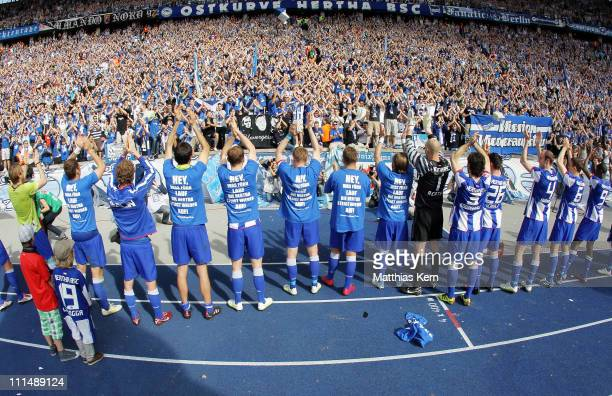 Players of Berlin celebrate with their fans after winning the Second Bundesliga match between Hertha BSC Berlin and SC Paderborn 07 at Olympic...
