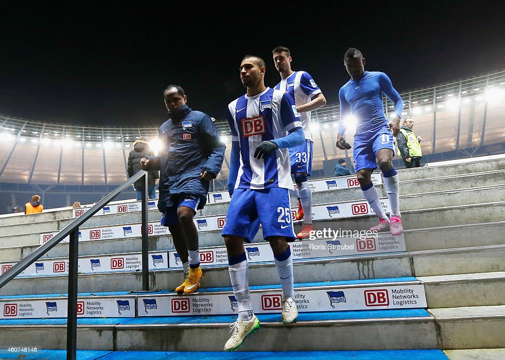 Players of Berlin leave the pitch after losing the Bundesliga match between Hertha BSC and 1899 Hoffenheim at Olympiastadion on December 21, 2014 in Berlin, Germany.