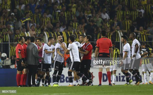 Players of Besiktas argue with the referee after the Turkish Super Lig week 6 soccer match against Besiktas at Ulker Stadium in Istanbul Turkey on...