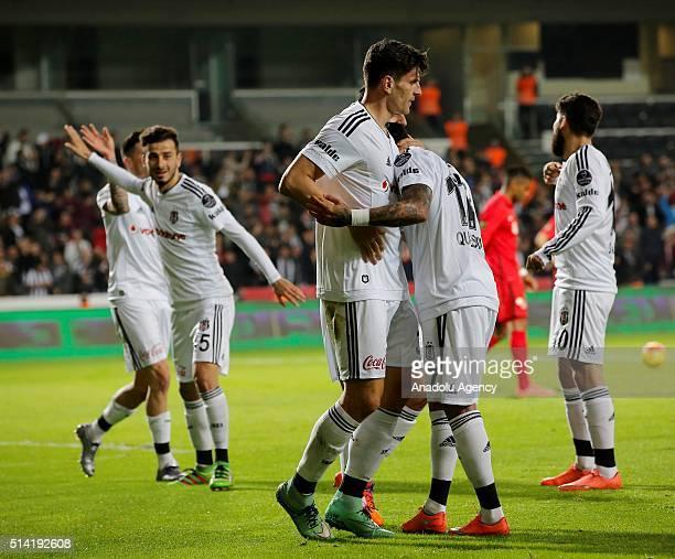 Players of Besiktas celebrate after scoring during the Turkish Spor Toto Super Lig football match between Besiktas and Eskisehirspor at the...