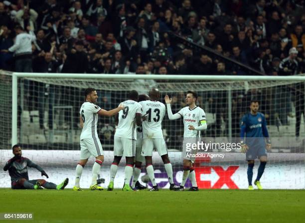 Players of Besiktas celebrate scoring a goal during the UEFA Europa League Round 16 secondleg match between Besiktas and Olympiacos at Vodafone Arena...