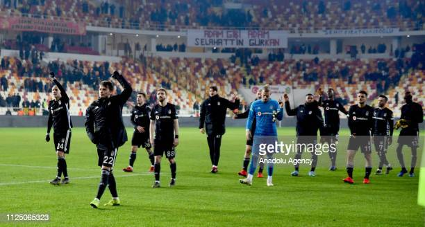 Players of Besiktas celebrate their victory with Besiktas' fans after Turkish Super Lig soccer match between Evkur Yeni Malatyaspor and Besiktas at...