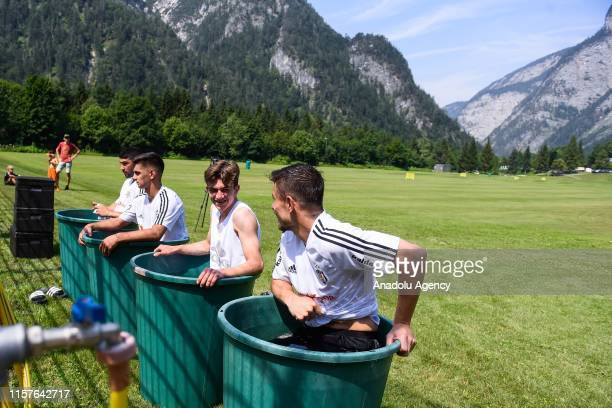 Players of Besiktas cool off after attending a training session within summer camp as part of the Turkish Super Lig new season preparations in...