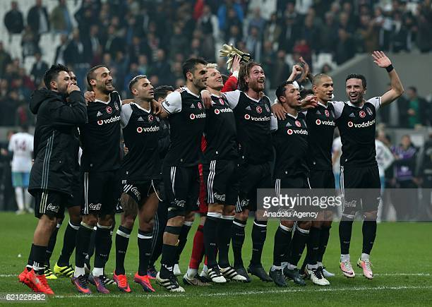 Players of Besiktas greet supporters after winning the Turkish Spor Toto Super Lig football match between Besiktas and Trabzonspor at Vodafone Arena...