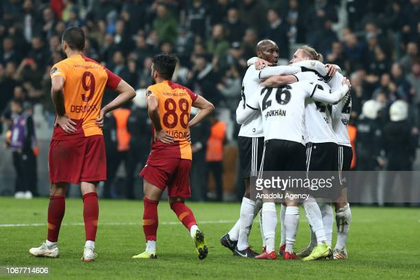 Players of Besiktas hug each other as they celebrate after the Turkish Super Lig soccer match between Besiktas and Galatasaray at Vodafone Park in...