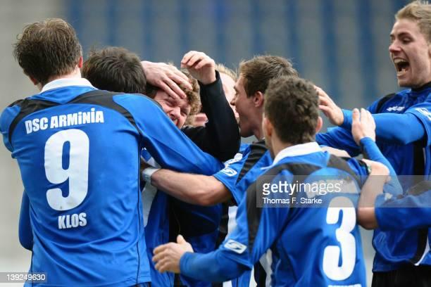 Players of Bielefeld and head coach Stefan Kraemer celebrate their teams first goal during the Third League match between Arminia Bielefeld and Jahn...