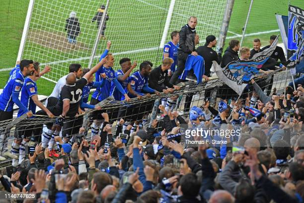 Players of Bielefeld celebrate after winning the Second Bundesliga match between DSC Arminia Bielefeld and SC Paderborn 07 at Schueco Arena on May 03...