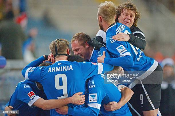 Players of Bielefeld celebrate their teams first goal with head coach Stefan Kraemer during the Second Bundesliga match between Arminia Bielefeld and...