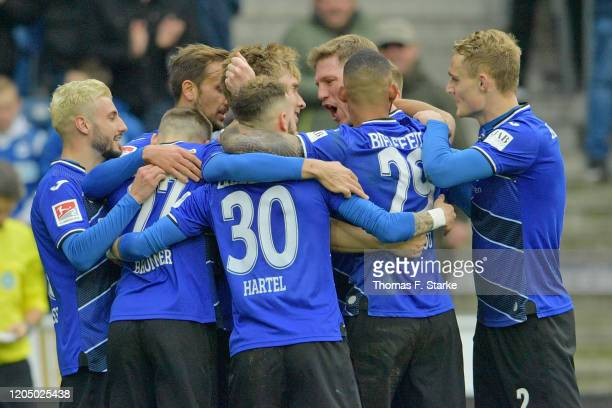 Players of Bielefeld celebrate their teams second goal during the Second Bundesliga match between DSC Arminia Bielefeld and SSV Jahn Regensburg at...