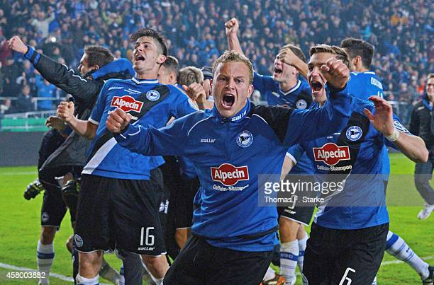Players of Bielefeld celebrate winning the DFB Cup match between Arminia Bielefeld and Hertha BSC at Schueco Arena on October 28 2014 in Bielefeld...