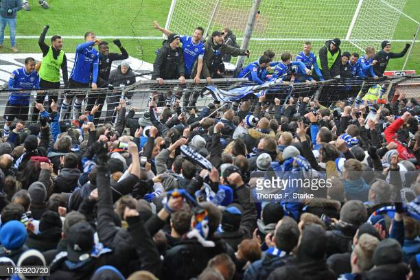 Players of Bielefeld celebrate with their supporters after winning the Second Bundesliga match between DSC Arminia Bielefeld and Hamburger SV at...