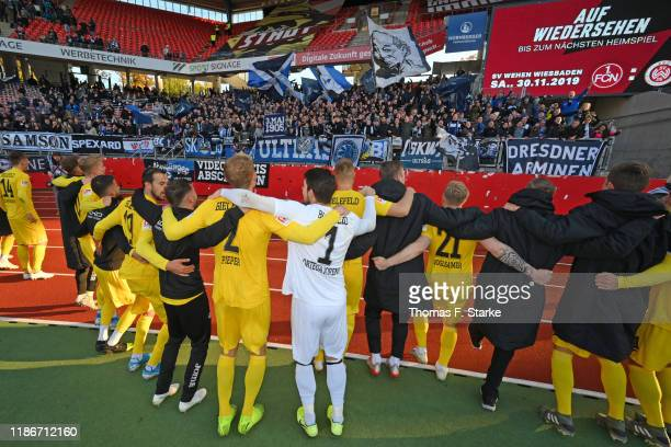 Players of Bielefeld celebrate with their supporters after winning the Second Bundesliga match between 1. FC Nuernberg and DSC Arminia Bielefeld at...