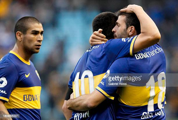 Players of Boca Juniors celebrate the first goal during a match between Boca Juniors and Colon as part of the 13th round of the Torneo Inicial 2013...