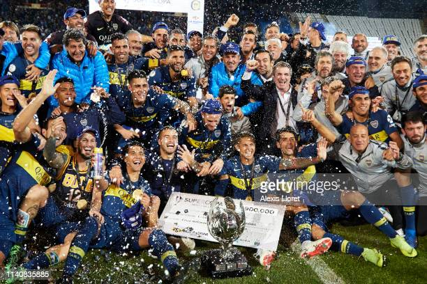 Players of Boca Juniors celebrate winning with the Supercopa Argentina trophy after a match between Boca Juniors and Rosario Central as part of...