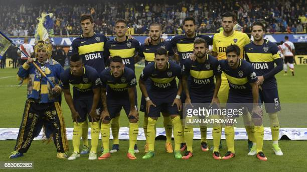 Players of Boca Juniors pose for pictures before the start of the Argentina first division football match against River Plate at the La Bombonera...