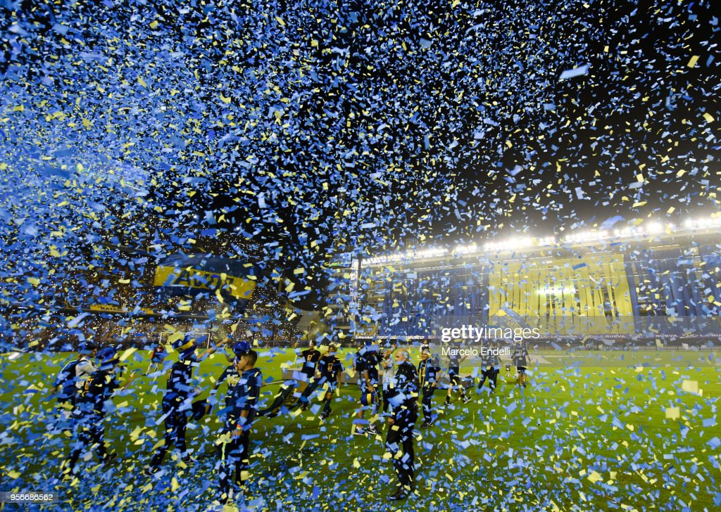 Players of Boca Juniors showered by confetti during the celebration event after winning the Argentina Superliga 2017/18 at Estadio Alberto J. Armando on May 9, 2018 in La Boca, Argentina. Boca Juniors fans could not attend the game against Gimnasia y Esgrima La Plata as no away fans are allowed in Argentina.