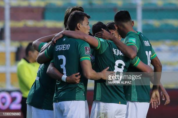 Players of Bolivia celebrate after defeating Venezuela 3-1 in their South American qualification football match for the FIFA World Cup Qatar 2022 at...