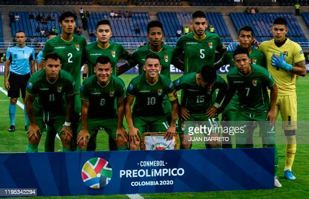 Players of Bolivia pose for pictures before the start of their Under-23 South American Pre-Olympic Tournament football match against Paraguay at...