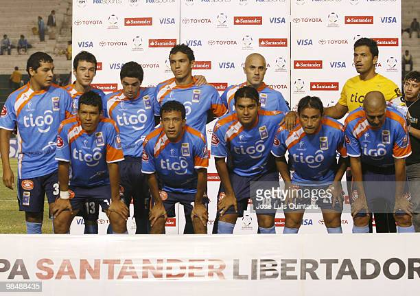 PLayers of Bolivia's Blooming pose for a photograph before a match against Libertad at Ramon Aguilera Costa Stadium on April 15 2010 in Santa Cruz...