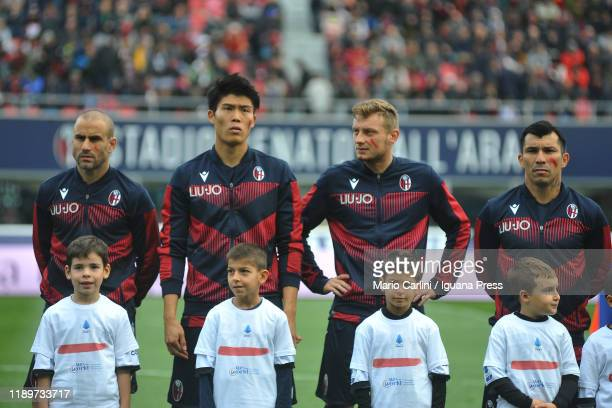 Players of Bologna FC show the red sign on their cheeks for 'a red against the violence' during the Serie A match between Bologna FC and Parma Calcio...