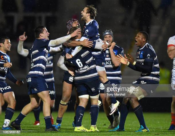 Players of Bordeaux Begles celebrate their win over Sale Sharks at the end of the match during the Challenge Cup match between Sale Sharks and...