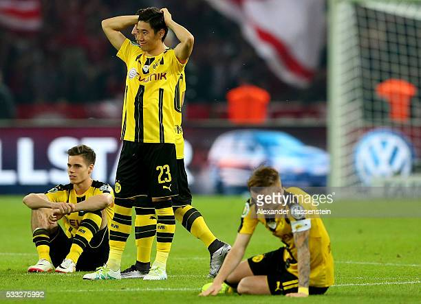 Players of Borussia Dortmund look dejected after loosing the DFB Cup Final 2016 between Bayern Muenchen and Borussia Dortmund at Olympiastadion on...