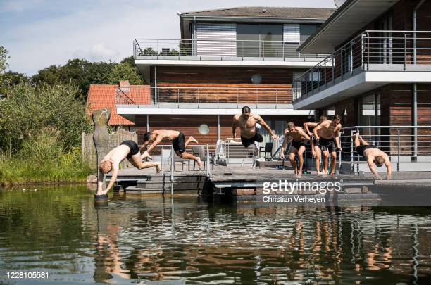 Players of Borussia jump into a swimming pond next to their Hotel during the Training Camp of Borussia Moenchengladbach at Klosterpforte on August...