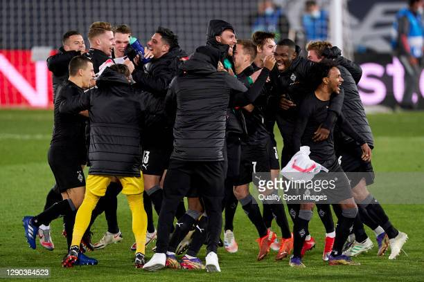 Players of Borussia Moenchengladbach celebrate qualifying to the next round after the UEFA Champions League Group B stage match between Real Madrid...