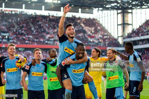 Players of Borussia Moenchengladbach celebrate their teams win after the Bundesliga match between 1 FC Koeln and Borussia Moenchengladbach at...