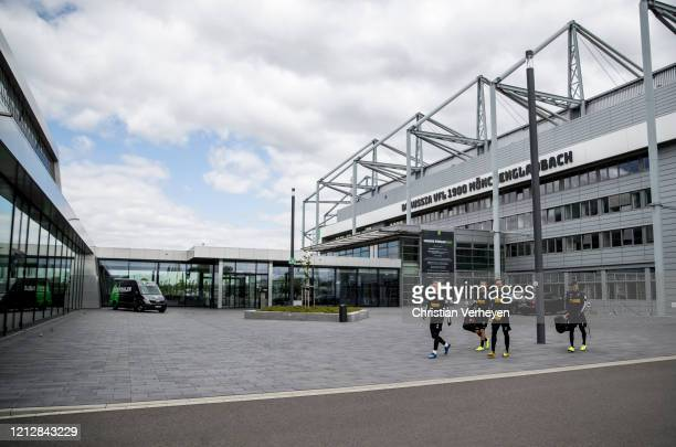 Players of Borussia Moenchengladbach on their way to the training pitch are seen during a training session of Borussia Moenchengladbach at...