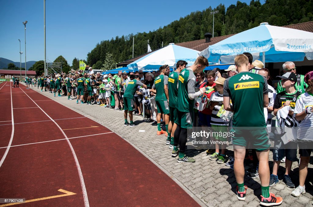 Players of Borussia Moenchengladbach sign for the supporters after a training session at the Training Camp of Borussia Moenchengladbach on July 18, 2017 in Rottach-Egern, Germany.
